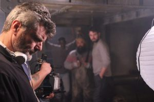Alec Gillis on set of his directorial debut, Harbinger Down.
